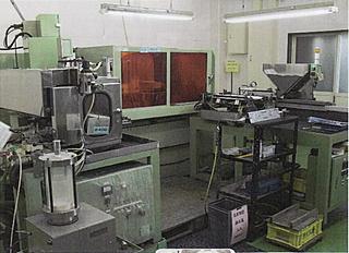 Semi-automatic tapeless NC grinder